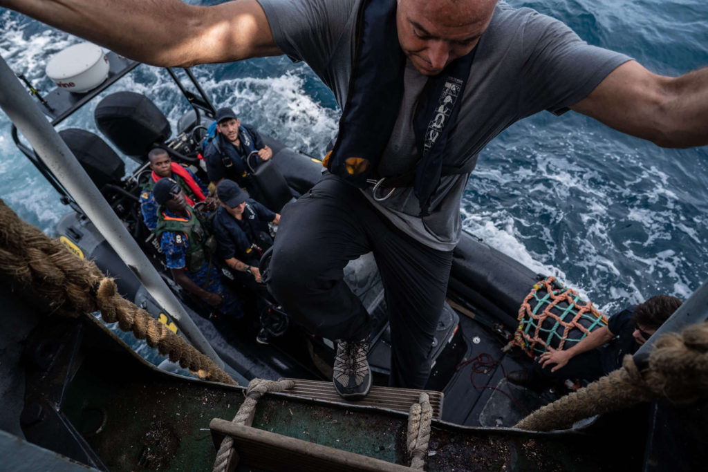 Ian-Urbina-climbs-into-speedboat-Gambia-Sea-Shepherd